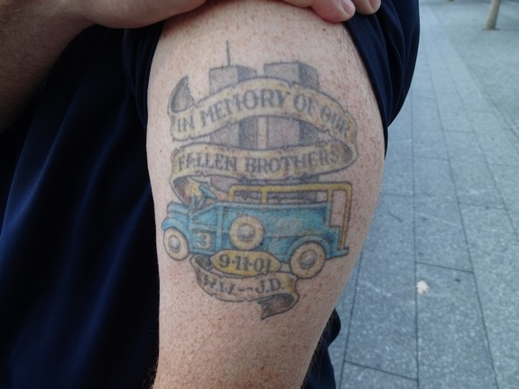 """David Brink's tattoo honoring the memory of those First Responders who died on 9/11. The tattoo says, """"In Memory of Our Fallen Brothers 9-11-2001 W.W. [Walter Weaver] - J.D. [Jerome Dominguez]"""" - Photo by Nehemia Gordon"""